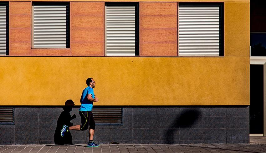 man running in a blue shirt