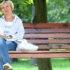 woman thinking about a bone density scan on a park bench
