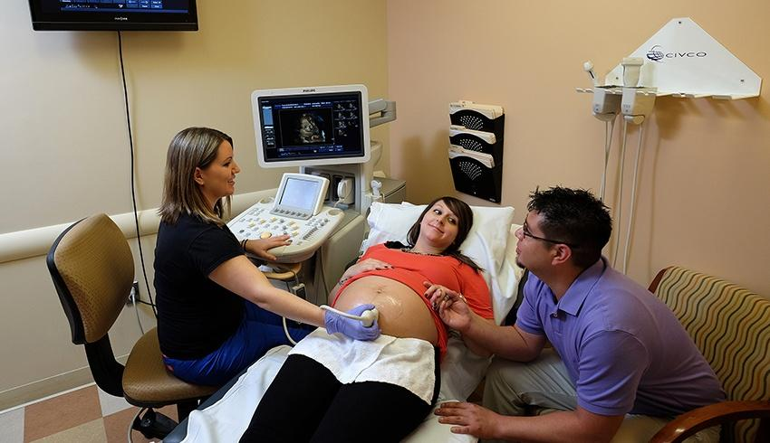 woman receiving an ultrasound in a diagnostic imaging center