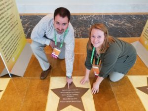 Two MIF staff members posing next to their award