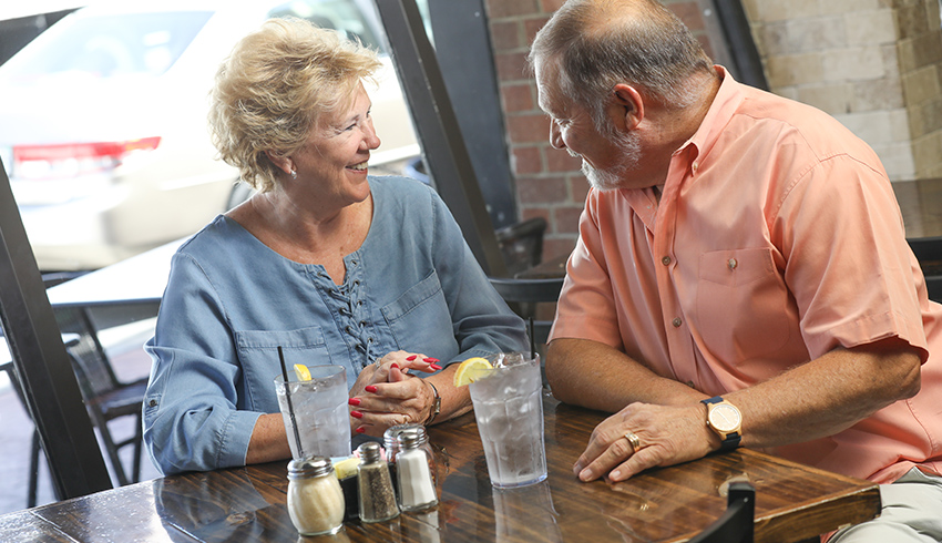 man at a restaurant with his wife