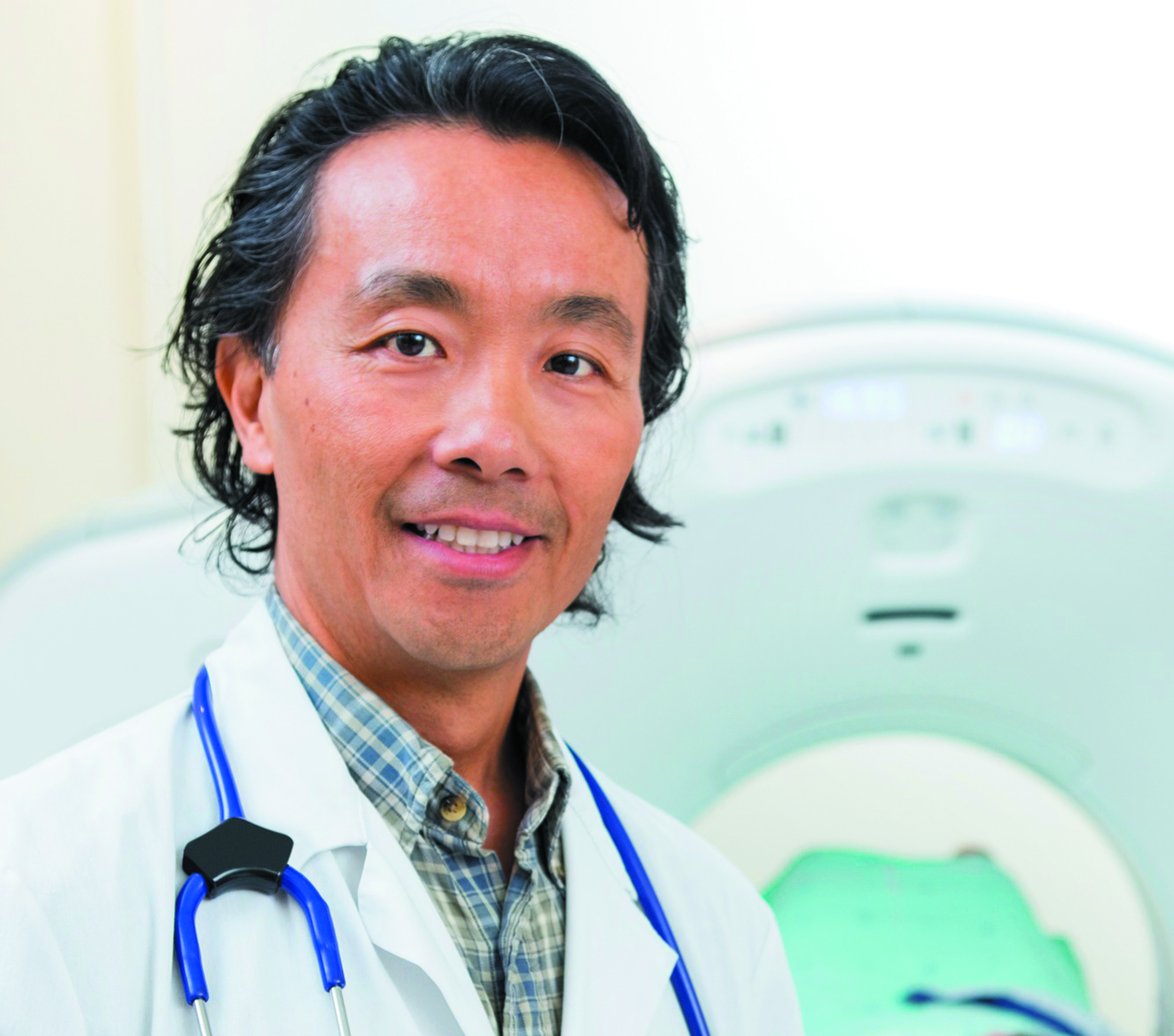 doctor in front of medical imaging equipment