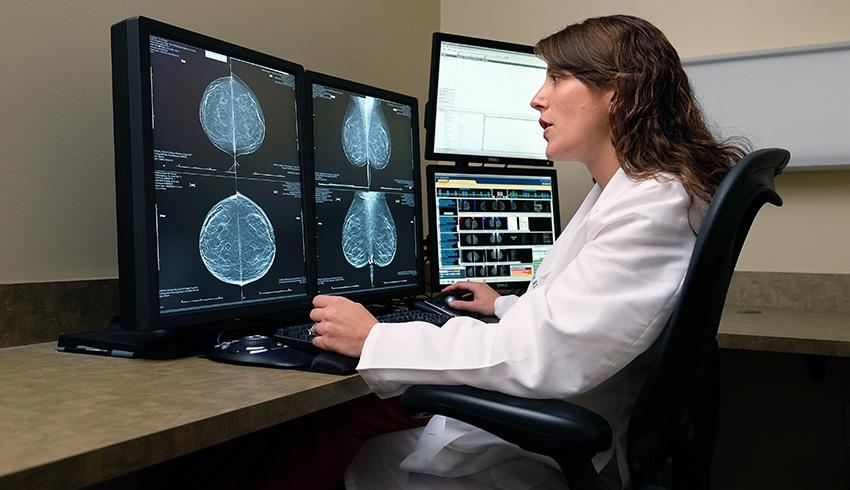 doctor analyzing the results of a 3d mammogram