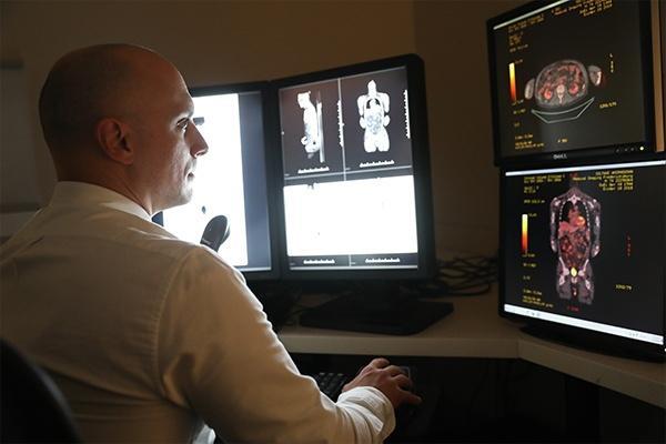 Radiologist examining True Open MRI scans