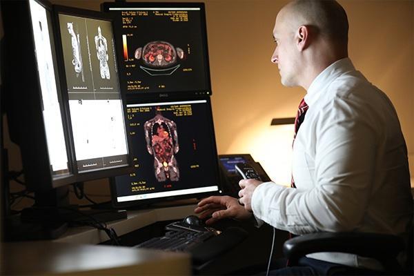 Radiologist examining True Open MRI scans2