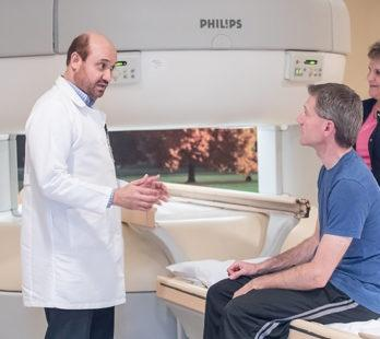 patient and radiologist at the true open mri