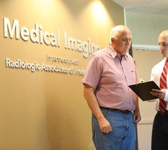 radiologist speaking to patient at medical imaging of fredericksburg